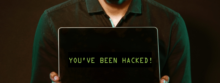 "Man with Laptop that says ""you've been hacked!"""