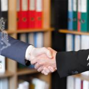 Handschlag Nationaler Pakt Cybersicherheit des BMI und der AG KRITIS